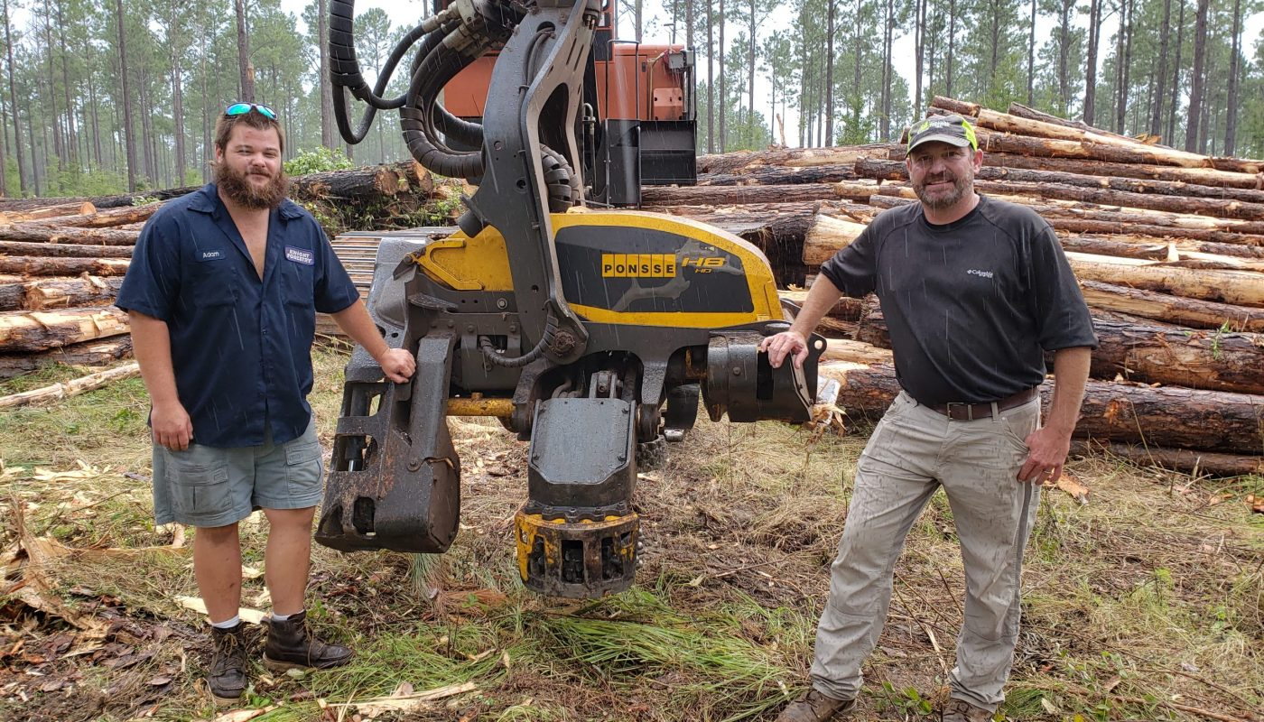Jason Knight (right), owner of Knight Forestry, one of two new Ponsse dealers in the Southeast, shown with a Ponsse H8 HD harvester head. Also shown is (left) Adam Knight. Knight Forestry is located in southwest Georgia